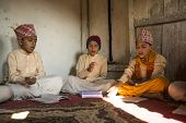 KATHMANDU, NEPAL - DEC 9, 2013: Unknown children during the reading of texts in Sanskrit at Jagadgur