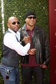 LOS ANGELES - APR 13:  Romany Malco, LL Cool J at the John Varvatos 11th Annual Stuart House Benefit