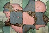 A Grunge Background with Old Floor Tiles and Broken Glass Border