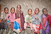 AFRICA, TANZANIA-FEBRUARY 9, 2014: Portrait on unidentified African Kids of Masai  tribe village smi