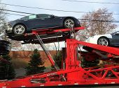 SPRINGFIELD, NJ - APRIL 14: New Model S cars lie on a truck outside a Tesla Service facility on Apri