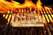 stock photo of flames  - Grilled Pork Striploin and BBQ Flames - JPG