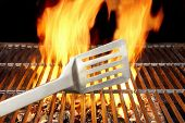 pic of gril  - BBQ Gril Spatula and Flames in background - JPG
