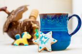 Blue Mug And Christmas Gingerbread Cake Star Icing Decoration