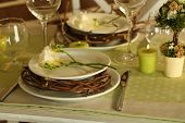 Beautiful holiday Easter table setting in green tones, close-up