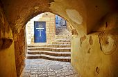 picture of israel people  - An alley tunnel and church door in the old city of Jaffa Tel Aviv Israel - JPG