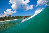 Surfing A Wave.gland Surf Area.indonesia.