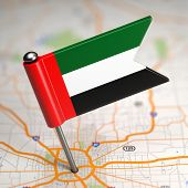 UAE Small Flag on a Map Background.