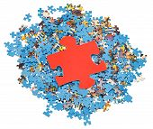 Big Red Piece On Pile Of Disassembled Puzzles
