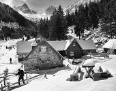 Trekker leaving a chalet in the mountains