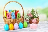 image of ear candle  - Composition with funny handmade Easter rabbits in wicker basket - JPG