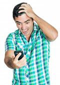 Desperate angry man looking at his mobile phone with a furious expression (isolated on white)