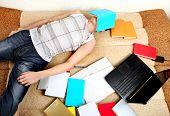 Hard Tired Student On Sofa