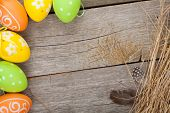 Easter eggs over wooden background with copy space