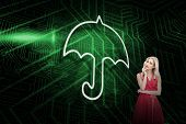 Composite image of umbrella and sexy blonde against green and black circuit board