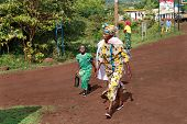 African People, Women And Child Stepping On Rural Road