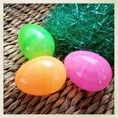 Instagram style image of plastic Easter eggs and grass
