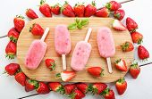 Homemade Ice Cream Pops With Fresh Berries.