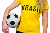 Football fan in brasil tshirt on white background
