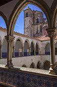 Tomar, Portugal - July 18, 2013: Washing Cloister and church bell tower in the Templar Convent of Ch