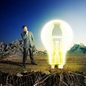 Businessman on the nature with big idea