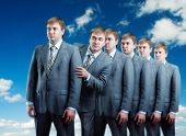 Queue of businessmans isolated on sky view