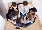 Businesspeople Making Huddle