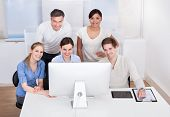 Group Of Businesspeople Working On Computer