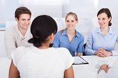 Happy Businesspeople Talking In Office