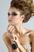 Beautiful woman with bracelet and stage make-up