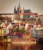 Vintage retro hipster style travel image of Mala Strana and  Prague castle over Vltava river with grunge texture overlaid. Prague, Czech Republic