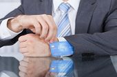 Businessperson Removing Credit Card From Sleeve