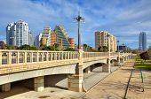 Bridge across old river bed of Turia and contemporary residential buildings on background in Valenci