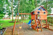 picture of chute  - Beautiful playground with swings chute and small cute house with stairs - JPG