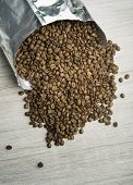 Coffee beans on white grunge wood