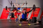 picture of barbell  - Barbell weight lifting group workout exercise at gym box - JPG