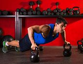 Kettlebells push-up man strength pushup exercise workout at gym