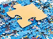 Big Piece On Pile Of Disassembled Puzzles