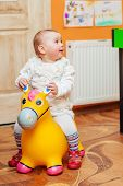 Little girl playing with toys in  playroom