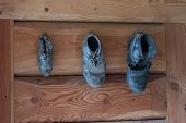 foto of chalet  - antiquity leather boots in wood chalet mountain - JPG