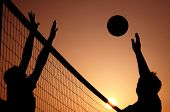 picture of volleyball  - people playing sand volleyball on the beach - JPG