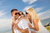 summer holidays, family, children and people concept - happy family in sunglasses having fun outdoor