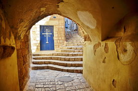 stock photo of israel people  - An alley tunnel and church door in the old city of Jaffa Tel Aviv Israel - JPG
