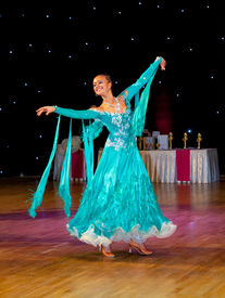 picture of waltzing  - Female dancer performs at dance championship - JPG