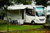 Caravan with a awning at a camp site, big white caravan on camping