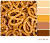 A background of golden pretzels, in a colour palette with complimentary colour swatches.
