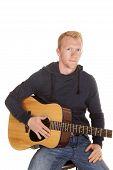 Man In Hoodie With Guitar Look Serious