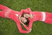 Middle Eastern women laying in grass