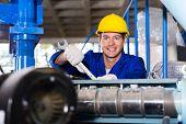 image of blue-collar-worker  - happy modern blue collar worker in factory - JPG