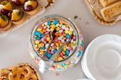 Multicolor bonbon sweets in a jar